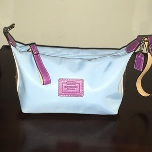 Coach blue makeup bag w/ a purple leather strap